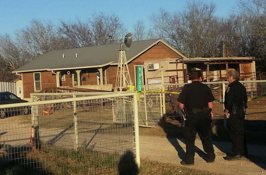 Police investigate the scene of a murder suicide at 9900 block of New Sulphur Springs. Photo: J. Almendarez, Express-News