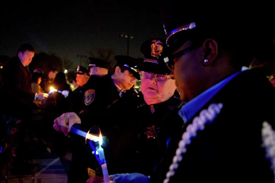 Bellaire Police Department officers light candles in remembrance of their colleague Sgt. Jimmie Norman during a vigil on Monday, the first anniversary of his death. Norman lost his life during a traffic-stop-turned-fatal. Read more about the remembrance on HoustonChronicle.com Photo: Marie D. De Jesus, Houston Chronicle / © 2013 Houston Chronicle