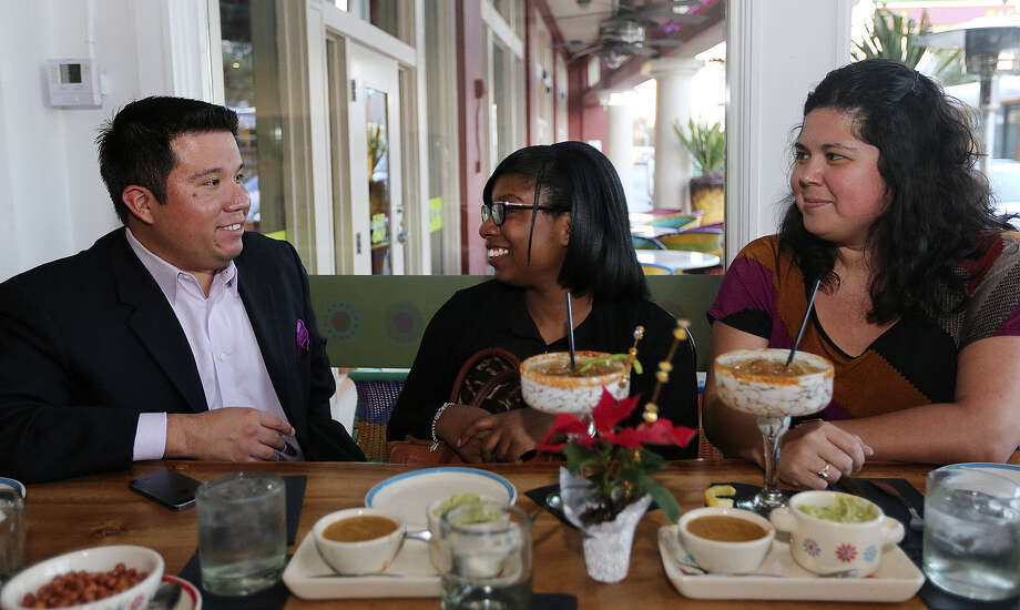 South Texas Hispanic Fund Chairman Jorge Herrera (from left) chats with donors Dorian Allmon and Becky Baily during a holiday party for donors Dec. 18 at Fruteria. Photo: San Antonio Express-News / ©2013 San Antonio Express-News