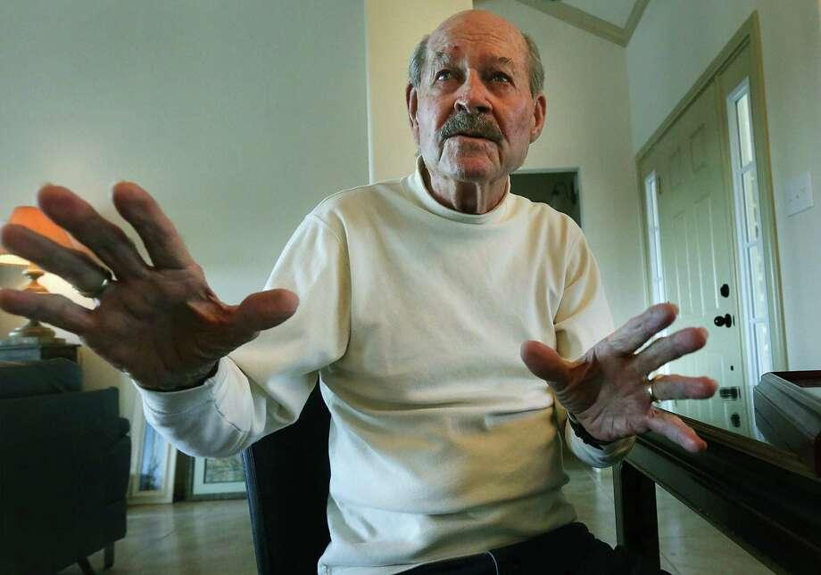 World War II combat medic Robert Parker says he remembers feeling numb after tending to injured soldiers. Photo: Bob Owen, San Antonio Express-News / © 2012 San Antonio Express-News