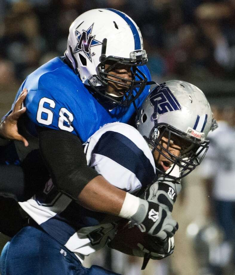 DL Jordan Wells, Sr., Navasota  Not pictured  DL Kingsley Keke, Jr., George Ranch Photo: Smiley N. Pool, Houston Chronicle