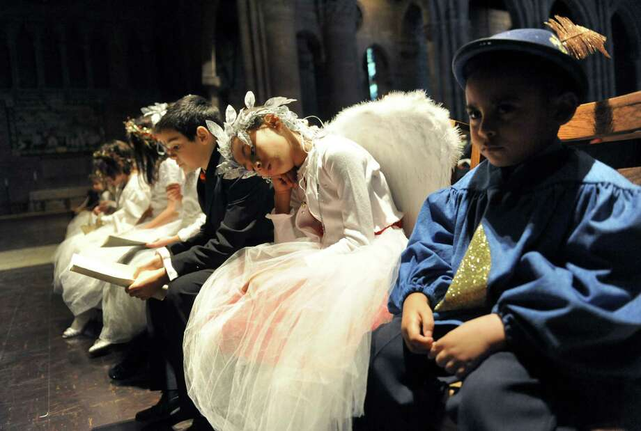 Sunday school students in costume wait to re-enact The Nativity of Jesus Christ during a Christmas Eve mass at The Cathedral of All Saints on Tuesday Dec. 24, 2013 in Albany, N.Y.  (Michael P. Farrell/Times Union) Photo: Michael P. Farrell / 00025140A