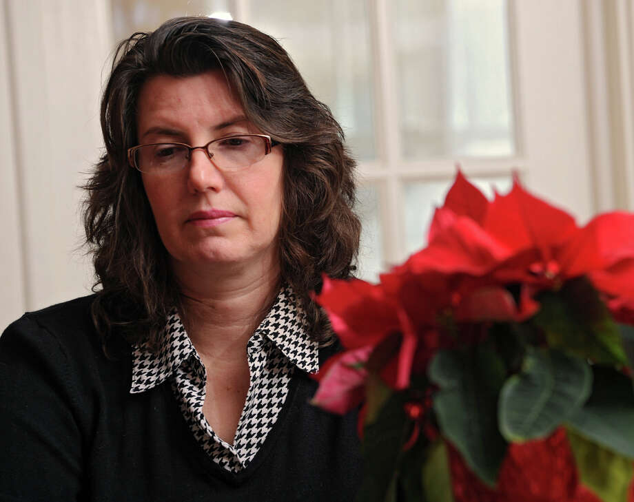 Holly McKenna, an instructor at UAlbany, talks about her son, Yousef Akkad, 30, at her home on Tuesday, Dec. 24, 2013 in Albany, N.Y. Her son was taken to Jordan by his father (her former husband) in 1986 when he was 5. Holly and her 18-yr-old daughter Cailin will be leaving this weekend to visit Yousef and his family. (Lori Van Buren / Times Union) Photo: Lori Van Buren / 00025142A