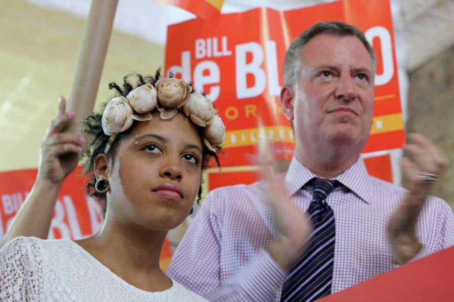 This Sept. 7, 2013 photo shows Democratic mayoral hopeful Bill de Blasio, right, and his daughter Chiara, during a campaign rally in the Brooklyn borough of New York. (AP Photo/Mary Altaffer, File) Photo: Mary Altaffer / AP