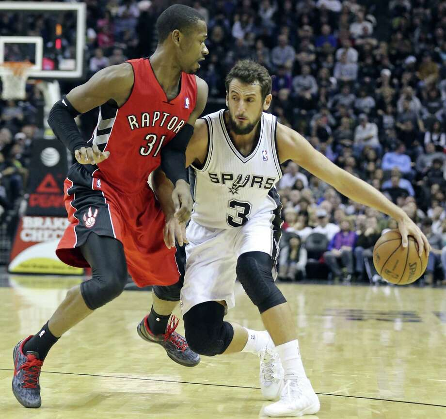 Marco Belinelli, going against Toronto's Terrence Ross on Monday, missed all five of his 3-point tries. Photo: Edward A. Ornelas / San Antonio Express-News / © 2013 San Antonio Express-News