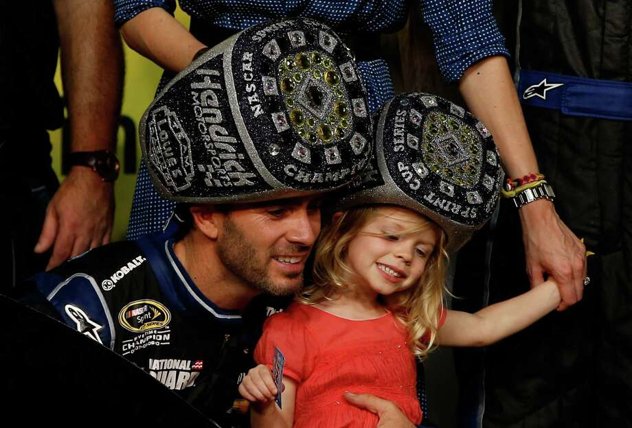 HOMESTEAD, FL - NOVEMBER 17:  Jimmie Johnson, driver of the #48 Lowe's/Kobalt Tools Chevrolet, celebrates in Champions Victory Lane with his daughter Genevieve Marie after winning the series championship following the NASCAR Sprint Cup Series Ford EcoBoost 400 at Homestead-Miami Speedway on November 17, 2013 in Homestead, Florida.  (Photo by Chris Graythen/Getty Images) ORG XMIT: 159337956 Photo: Chris Graythen / 2013 Getty Images