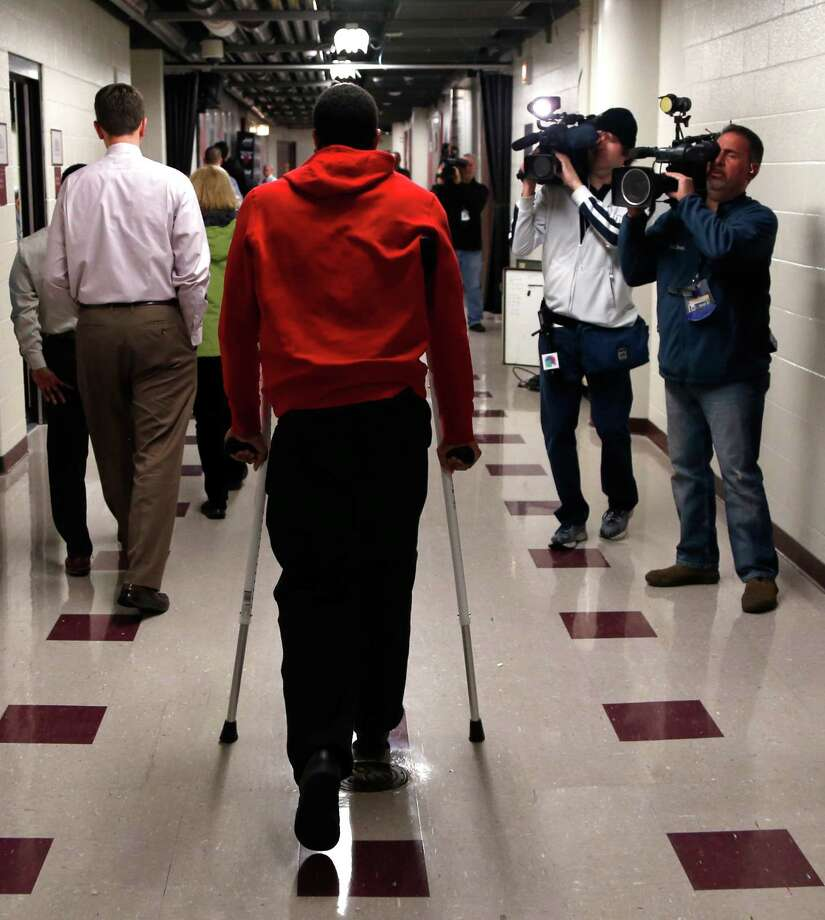 Chicago Bulls' Derrick Rose walks down a hall on crutches after an NBA basketball news conference about his injured knee at the United Center Thursday, Dec. 5, 2013, in Chicago. (AP Photo/Charles Rex Arbogast) ORG XMIT: ILCA108 Photo: Charles Rex Arbogast / AP