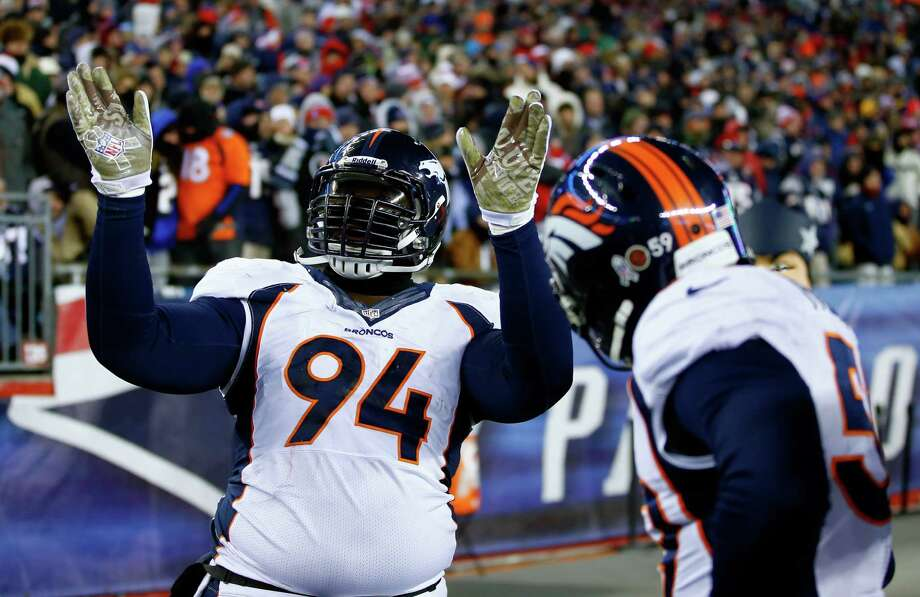 FOXBORO, MA - NOVEMBER 24: Defensive tackle Terrance Knighton #94 of the Denver Broncos celebrates after recovering a fumble against the New England Patriots during a game at Gillette Stadium on November 24, 2013 in Foxboro, Massachusetts.  (Photo by Jared Wickerham/Getty Images) ORG XMIT: 184892420 Photo: Jared Wickerham / 2013 Getty Images