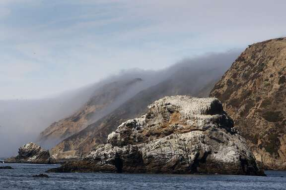 Chimney Rock is seen on the eastern tip of the Point Reyes peninsula during a cruise recreating explorer Sir Francis Drake's arrival at Drakes Bay in Point Reyes, Calif., on Friday, Sept. 11, 2009.