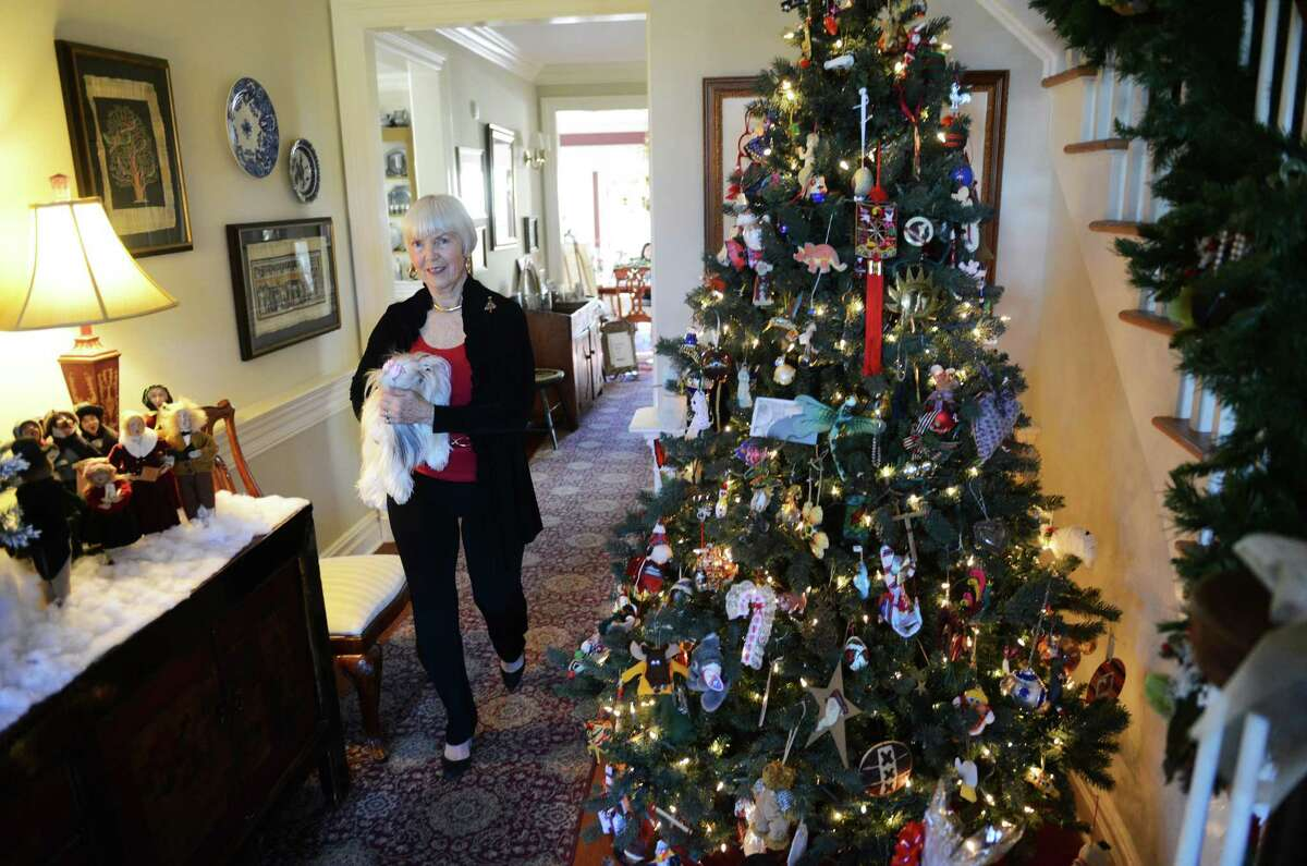 Bed and breakfast owner Jane Vouros works at the Dana-Holcombe House in Newtown, Conn. on Wednesday, Dec. 25, 2013. The inn keeps guests during the holidays and the owners enjoy their company, as it's part of their Christmas tradition.