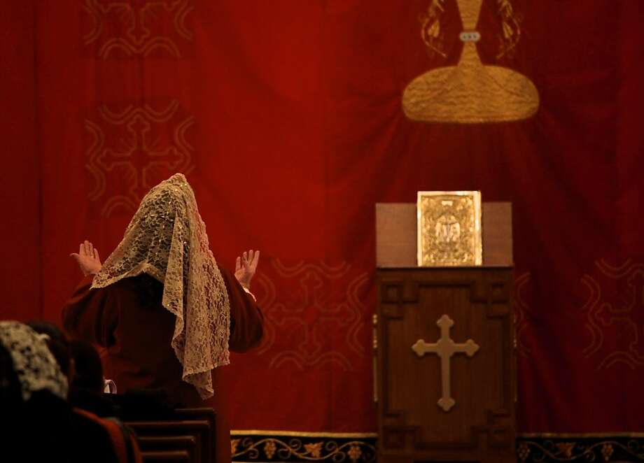 A Syrian Orthodox Christian prays in front of the altar at the Saint Afram Syrian Orthodox Church during the midnight Christmas Mass in Amman, Jordan, Tuesday, Dec. 24, 2013.  Hundreds of Syrian and Iraqi refugees along with Jordanian Christians attend the midnight Mass and pray for peace in their countries. Photo: Mohammad Hannon, AP