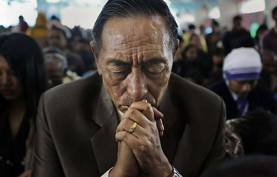 A Christian man prays during Christmas mass in a church in Gauhati, India, Wednesday, Dec. 25, 2013. Although Christians comprise only two percent of the population among a Hindu majority, the holiday is observed across the country as an occasion to celebrate. Photo: Anupam Nath, AP
