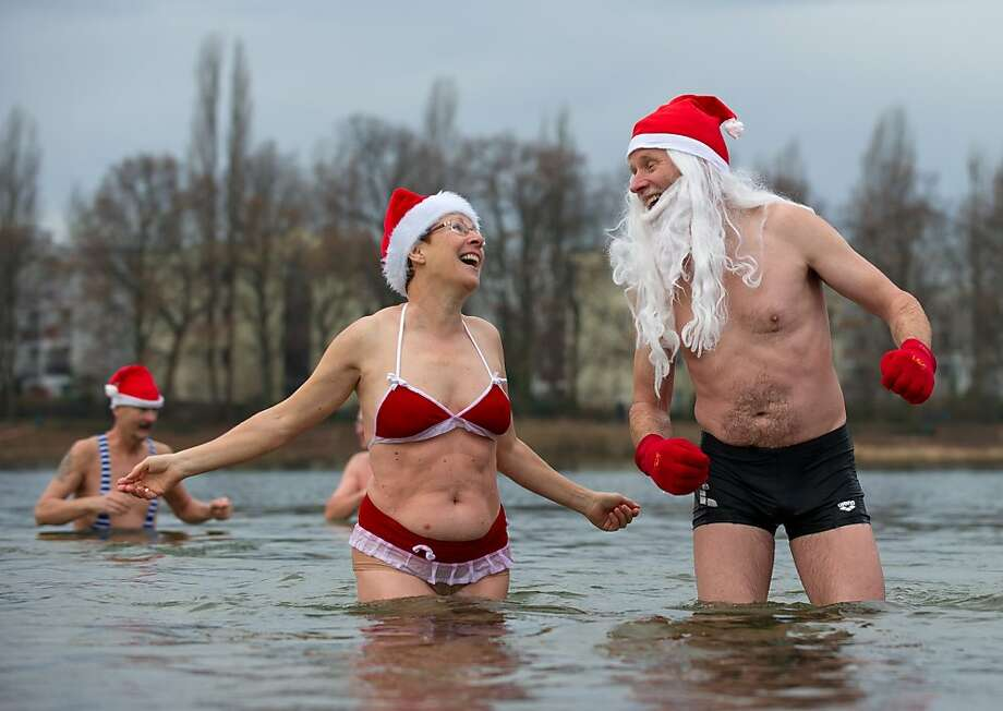 "Members of the ""Berlin Seals"" swim association take a bath in the Orankesee lake in Berlin during their tradtional Christmas Swimming on December 25, 2013. Temperatures in the German capital reached up to plus nine degrees Celsius. Photo: Tim Brakemeier, AFP/Getty Images"