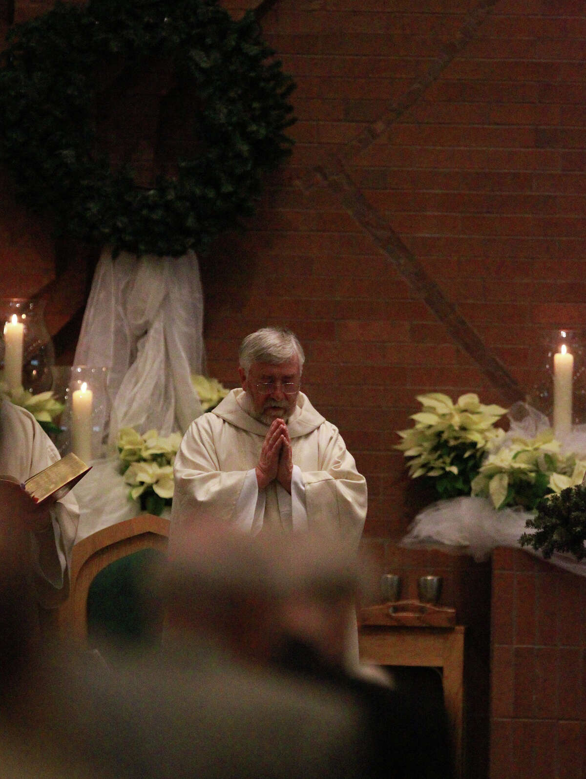 Father Kevin Ryan leads Christmas Mass Wednesday December 25, 2013 at St. Mark the Evangelist Catholic Church. The church is one of the largest Catholic parishes in San Antonio.