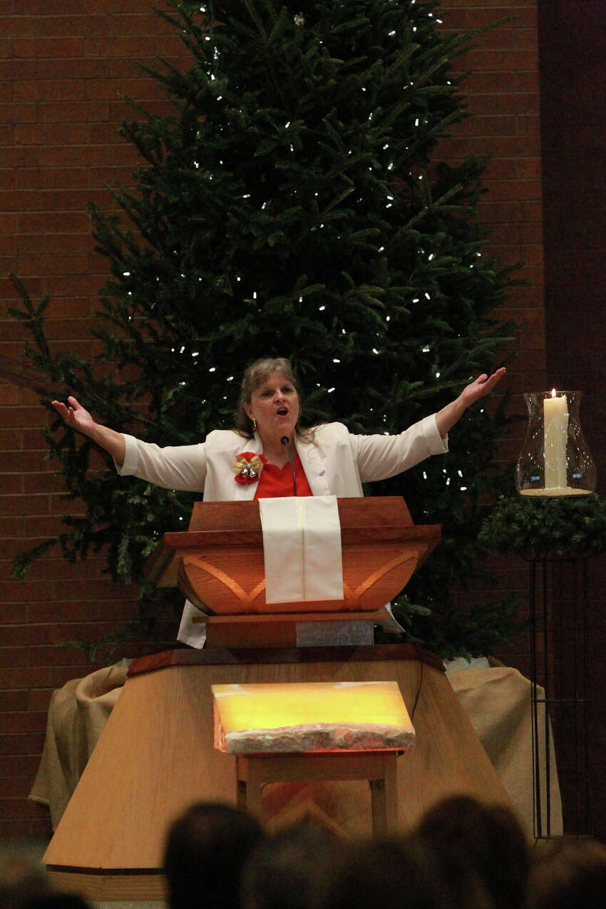 Kathy Frederick leads the congregation in song during Christmas Mass Wednesday December 25, 2013 at St. Mark the Evangelist Catholic Church. The church is one of the largest Catholic parishes in San Antonio
