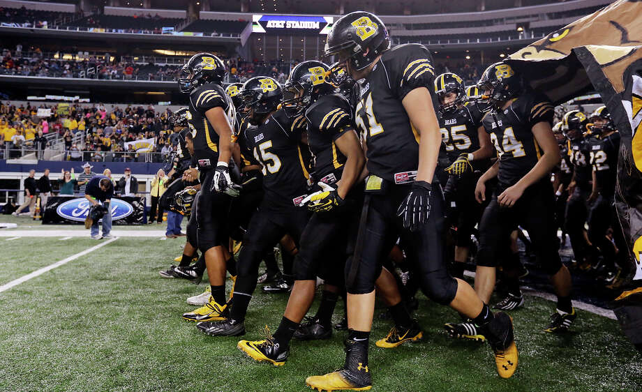 The Brennan Bears take the field before the Class 4A Division I state championship game with Denton Guyer on Dec. 20 at AT&T Stadium in Arlington. Photo: Edward A. Ornelas, San Antonio Express-News / © 2013 San Antonio Express-News