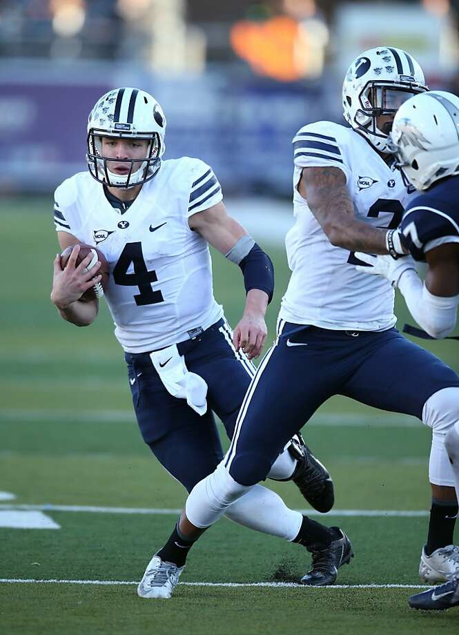 BYU quarterback Taysom Hill has emerged in his sophomore season, rushing for 1,211 yards and passing for 2,645 more. Photo: Cathleen Allison, Associated Press