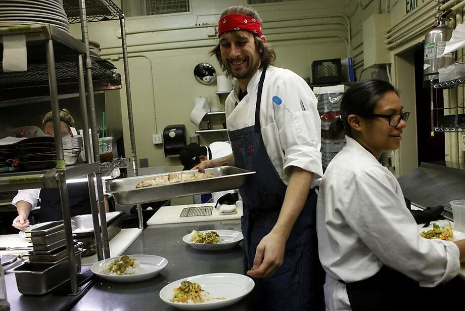 Sous chef Frank Hanes and line cook Maree Garcia work together in the kitchen, Friday December 20, 2013, at the Aziza Restaurant in San Francisco, Calif. Photo: Lacy Atkins, The Chronicle