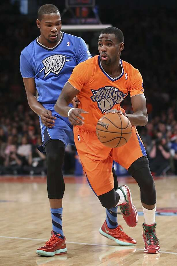 New York Knicks guard Tim Hardaway Jr. dribbles past Oklahoma City Thunder forward Kevin Durantduring the first half of an NBA basketball game at Madison Square Garden, Wednesday, Dec. 25, 2013, in New York.  Photo: John Minchillo, Associated Press