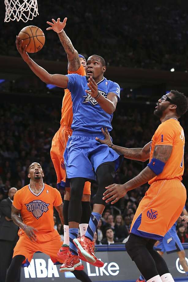 Oklahoma City Thunder forward Kevin Durant (35) shoots against New York Knicks forward Kenyon Martin, center, as guard J.R. Smith, left, and forward Amare Stoudemire (1) watch during the second half of an NBA basketball game at Madison Square Garden, Wednesday, Dec. 25, 2013, in New York. The Thunder won 123-94. Photo: John Minchillo, Associated Press