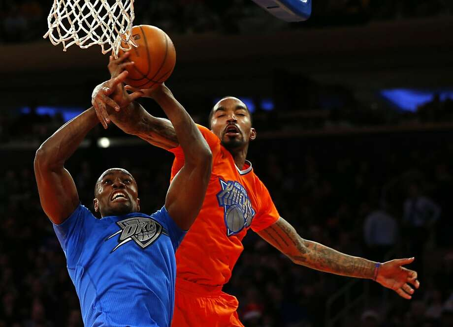 Serge Ibaka #9 of the Oklahoma City Thunder is fouled by J.R. Smith #8 of the New York Knicks in the second quarter during an NBA basketball game at Madison Square Garden on December 25, 2013 in New York City.  Photo: Rich Schultz, Getty Images