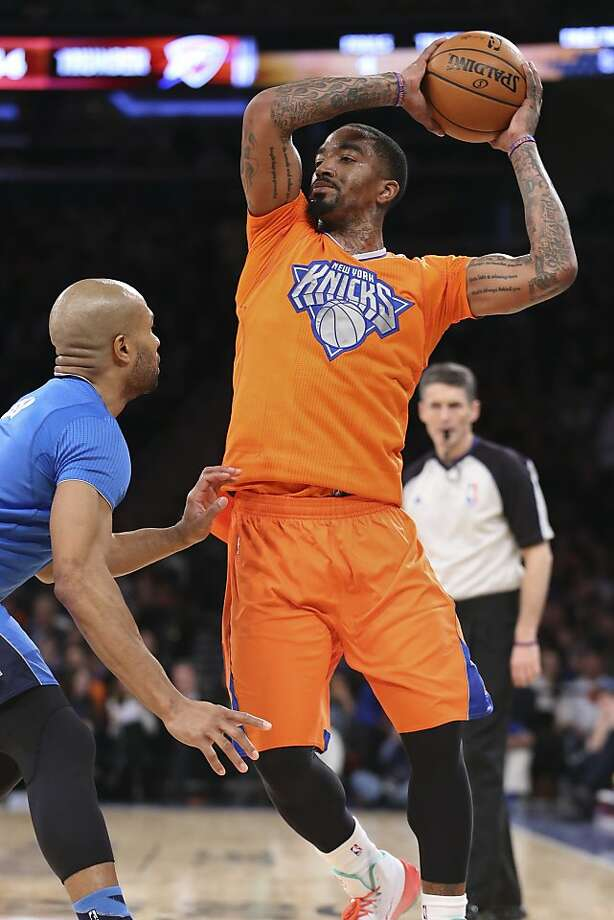 New York Knicks guard J.R. Smith (8) looks to pass over Oklahoma City Thunder guard Derek Fisher during the first half of an NBA basketball game at Madison Square Garden, Wednesday, Dec. 25, 2013, in New York.  Photo: John Minchillo, Associated Press