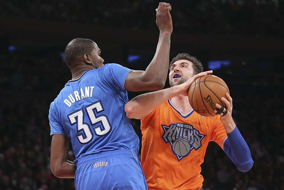 New York Knicks power forward Andrea Bargnani (77) shoots against Oklahoma City Thunder forward Kevin Durant (35) during the first half of their NBA basketball game at Madison Square Garden, Wednesday, Dec. 25, 2013, in New York. Photo: John Minchillo, Associated Press