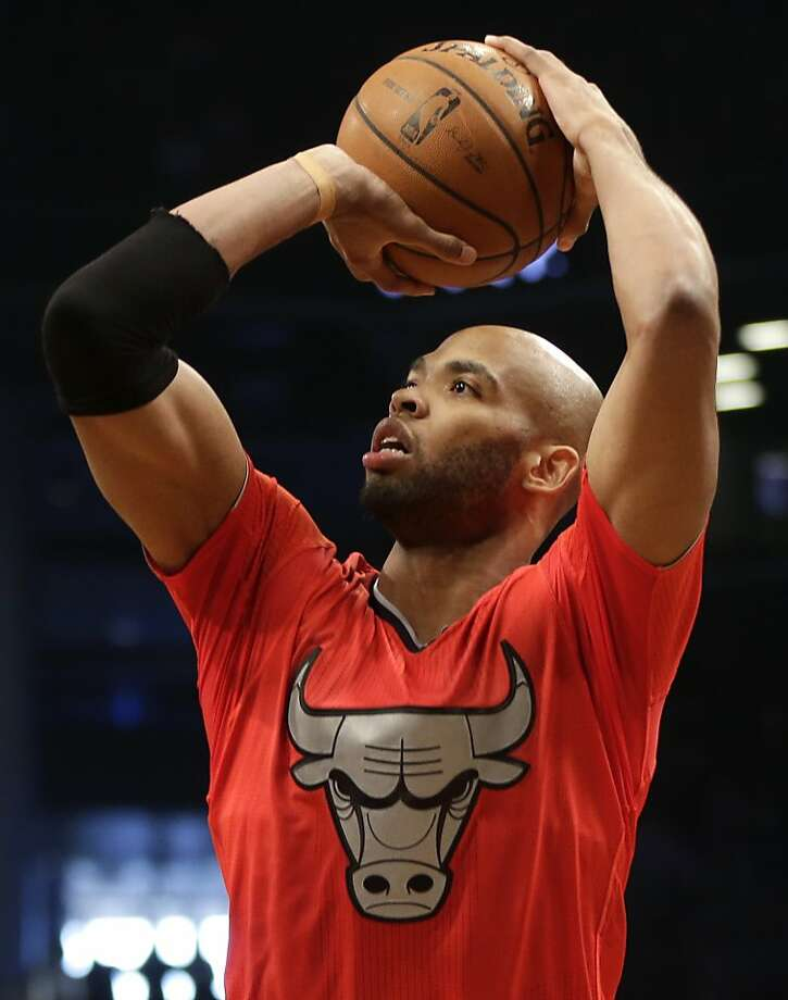 Chicago Bulls' Taj Gibson lines up a shot during the first half of the NBA basketball game against the Brooklyn Nets at the Barclays Center Wednesday, Dec. 25, 2013, in New York. Photo: Seth Wenig, Associated Press