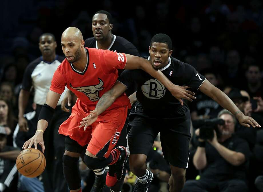 Brooklyn Nets' Joe Johnson, right, and Andray Blatche, center, pursue Chicago Bulls' Taj Gibson during the first half of the NBA basketball game at the Barclays Center Wednesday, Dec. 25, 2013, in New York.  Photo: Seth Wenig, Associated Press