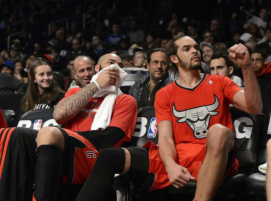 Carlos Boozer #5 (left) and Joakim Noah #13 (right) of the Chicago Bulls react to hecklers as they sit on the bench during the fourth quarter against the Brooklyn Nets at the Barclays Center on December 25, 2013 in the Brooklyn borough of New York City. NOTE TO USER: User expressly acknowledges and agrees that, by downloading and/or using this photograph, user is consenting to the terms and conditions of the Getty Images License Agreement. Photo: Christopher Pasatieri, Getty Images