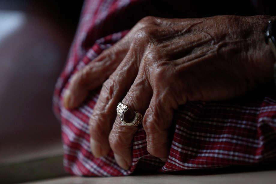 Retired jockey Herbie Hinojosa wears a horseshoe ring at his home in Brownsville on Wednesday, Nov. 13, 2013. Photo: Lisa Krantz, San Antonio Express-News / San Antonio Express-News