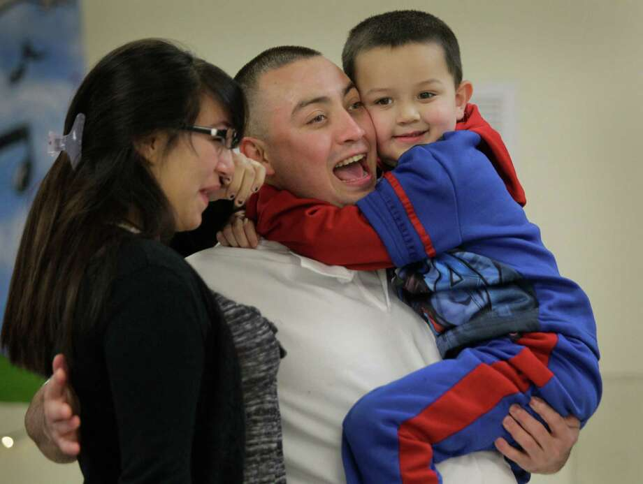 Inmate Daniel Ortega hugs his children, Alyssa Tate, 14, and Daniel Ortega Jr., 4,  after arriving for the Angel Tree event at the Texas Department of Criminal Justice Carol Vance Unit Saturday, Dec. 7, 2013, in Richmond. The inmates are part of InnerChange Freedom Initiative, a faith based pre-release program, at the TDCJ Carol Vance Unit. Photo: Melissa Phillip, Houston Chronicle / © 2013  Houston Chronicle