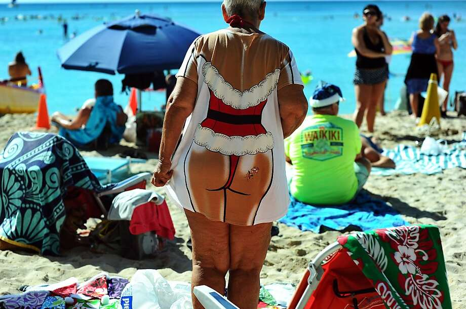 People enjoy at Waikiki beach during Christmas day in Honolulu on December 25, 2013. Photo: Jewel Samad, AFP/Getty Images