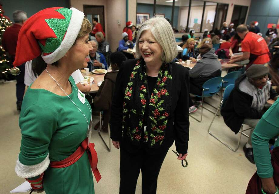 Charmaine Smith, director of The Family Residence chats with Jonina Dickey, in the lunchroom at The Salvation Army Greater Houston Area Command which served a Christmas day meal to hundreds of local men, women and children, Wednesday, Dec. 25, 2013, in Houston. Photo: Karen Warren, Houston Chronicle / © 2013 Houston Chronicle