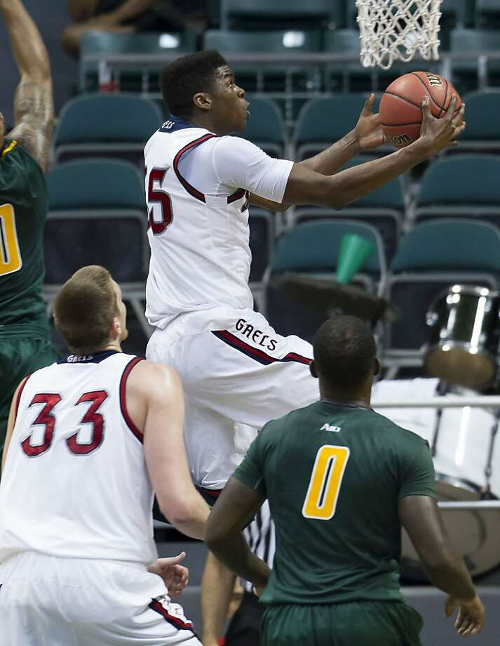 James Walker III, who scored 14 points for the Gaels, takes a shot as Matt Hodgson and George Mason's Byron Allen watch. Photo: Eugene Tanner, Associated Press