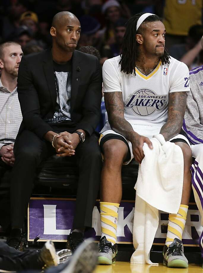 Los Angeles Lakers guard Kobe Bryant, left, and Jordan Hill sift on the bench during the first half of the Lakers' NBA basketball game against the Miami Heat in Los Angeles, Wednesday, Dec. 25, 2013. Photo: Chris Carlson, Associated Press