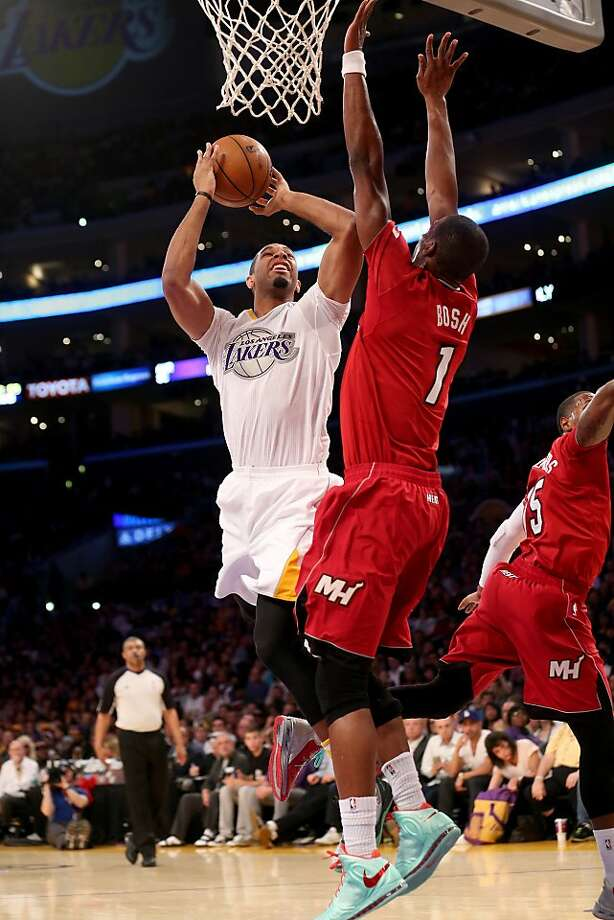 Xavier Henry #7 of the Los Angeles Lakers shoots over Chris Bosh #1 of the Miami Heat at Staples Center on December 25, 2013 in Los Angeles, California. Photo: Stephen Dunn, Getty Images