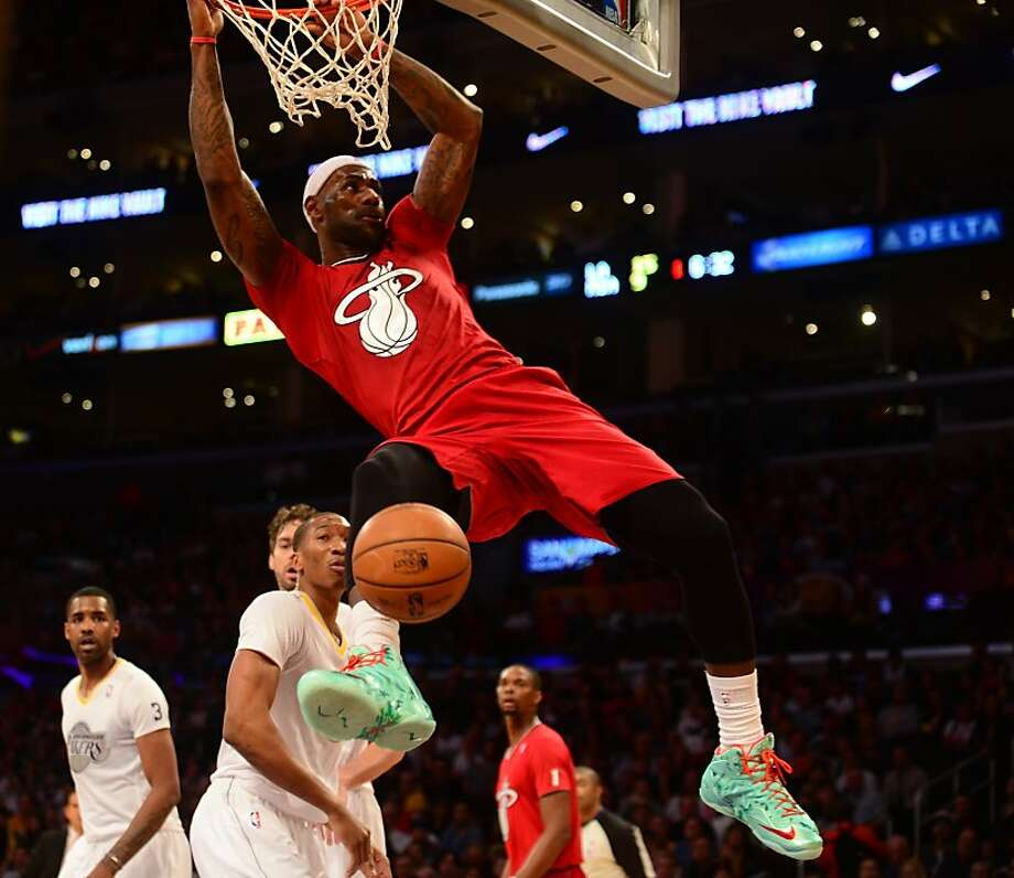 LeBron James of the Miami Heat scores against the Los Angeles Lakers during their Christmas Day  NBA matchup at Staples Center in Los Angeles, California on December 25, 2013. Photo: Frederic J. Brown, AFP/Getty Images