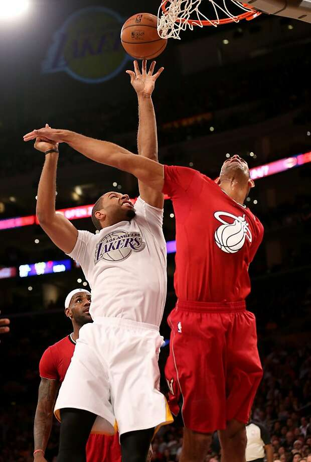 Xavier Henry #7 of the Los Angeles shoots over Shane Batttier #31 of the Miami Heat Lakers at Staples Center on December 25, 2013 in Los Angeles, California.  Photo: Stephen Dunn, Getty Images