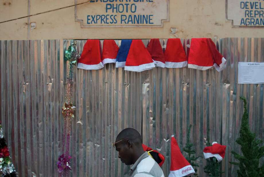 Santa hats are one of the limited Christmas offerings on sale in downtown Bangui, Central African Republic, Tuesday, Dec. 24, 2013. In the nation's capital, riven by sectarian violence, Christmas shoppers were few this year. Those that did venture out found only a handful of vendors selling plastic toys and Christmas decorations. Photo: Rebecca Blackwell, Associated Press / AP