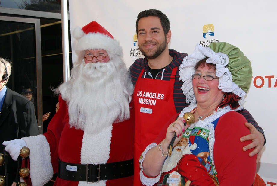Santa with actor Zachary Levi and Mrs. Claus at Christmas Eve At The Los Angeles Mission in Los Angeles on Dec. 24, 2010. Photo: Mark Sullivan, Getty Images / 2010 Mark Sullivan