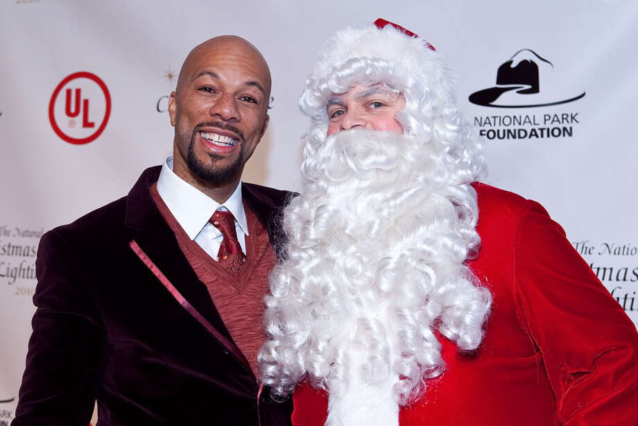Santa with rapper Common at the 2010 National Christmas Tree Lighting at President's Park in Washington, D.C.,  on Dec. 9, 2010. Photo: Paul Morigi, Getty Images / 2010 Paul Morigi