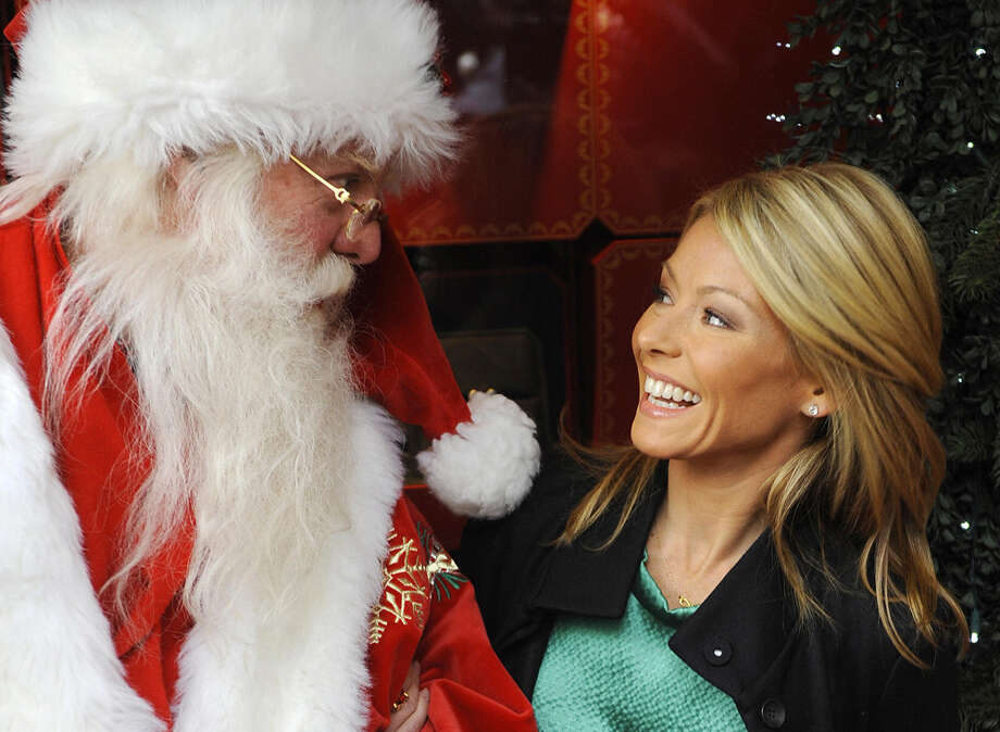 Santa with talk show host Kelly Ripa at the unveiling of Cartier's Christmas windows along Fifth Avenue in New York City on Nov. 24, 2008. Photo: EMMANUEL DUNAND, Getty Images / 2008 AFP