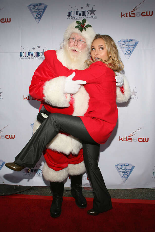 Santa with actress Hayden Panettiere at The 75th Annual Hollywood Christmas Parade in  Hollywood, Calif.,  on Nov. 26, 2006. Photo: Frederick M. Brown, Getty Images / 2006 Getty Images