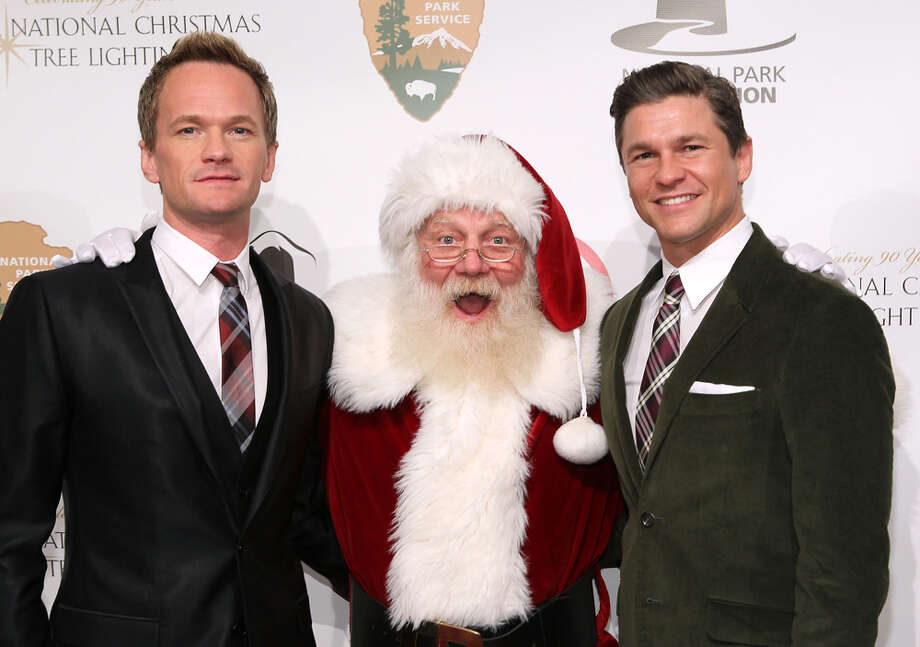 Santa with actor Neil Patrick Harris and his partner David Burtka at the 2012 National Christmas Tree Lighting Ceremony at President's Park in Washington, D.C.,  on Dec. 6, 2012. Photo: Paul Morigi, Getty Images / 2012 Paul Morigi