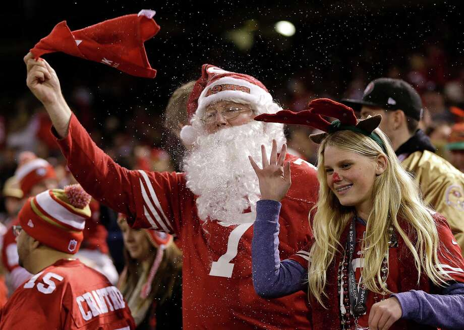 A San Francisco 49ers fan dressed as Santa Claus celebrates during the second half of the 49ers' NFL football game against the Atlanta Falcons in San Francisco, Monday, Dec. 23, 2013. Photo: Marcio Jose Sanchez, Associated Press / AP