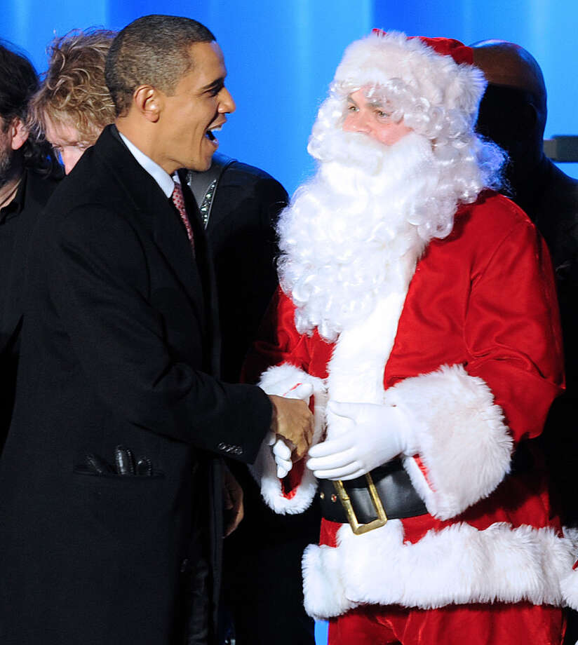 Santa with President Barack Obama at The 2009 National Christmas Tree Lighting in Washington, D.C., on Dec. 3, 2009. Photo: TIM SLOAN, Getty Images / 2009 AFP