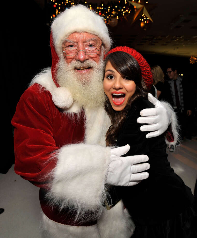 "Santa with actress Victoria Justice at the after party for ""Merry Christmas, Drake & Josh!"" at the Westside Pavillion in Westwood, Calif., on Dec. 2, 2008. Photo: Charley Gallay, Getty Images / 2008 WireImage"