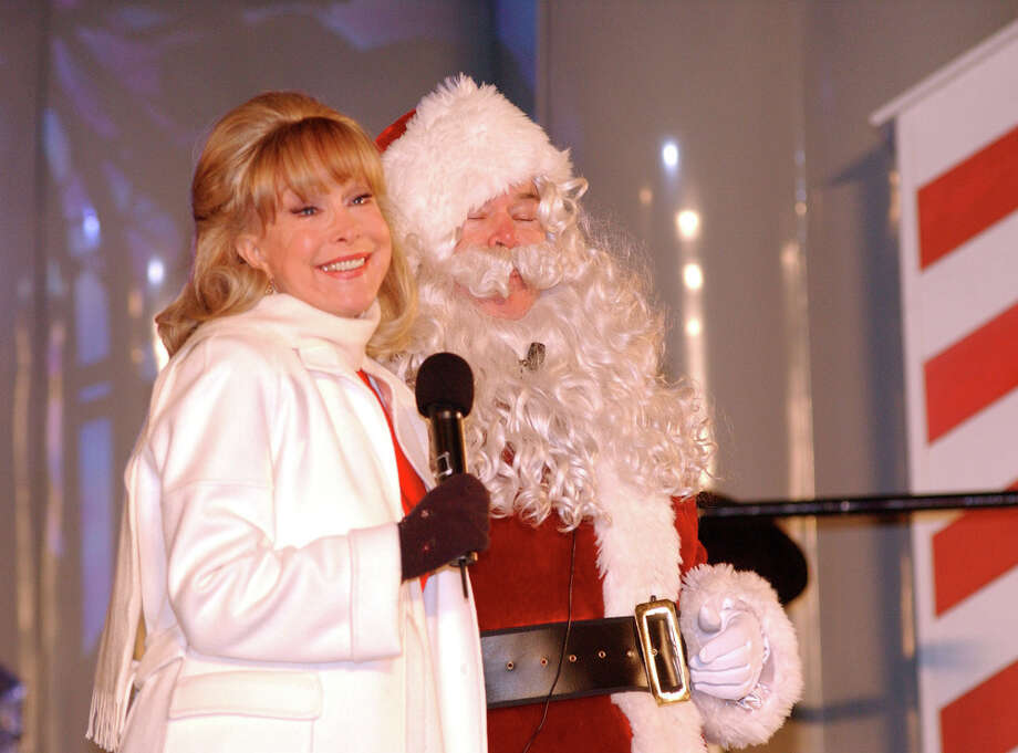 Santa with actress Barbara Eden at the Annual Pagent of Peace and the National Christmas Tree Lighting at the White House in 2002. Photo: Greg Mathieson/Mai, Getty Images / Greg Mathieson/Mai