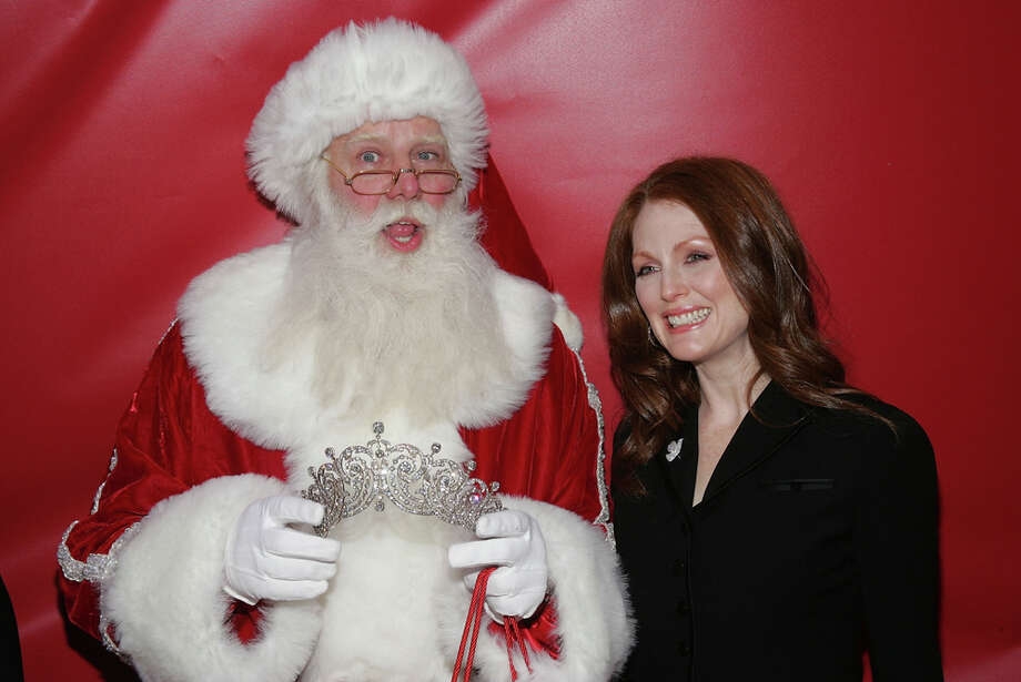 Santa with actress Julianne Moore at the 25th anniversary of the Cartier holiday bow celebration at The Cartier Mansion on Fifth Avenue in New York City on Nov. 16, 2004. Photo: Evan Agostini, Getty Images / 2004 Getty Images